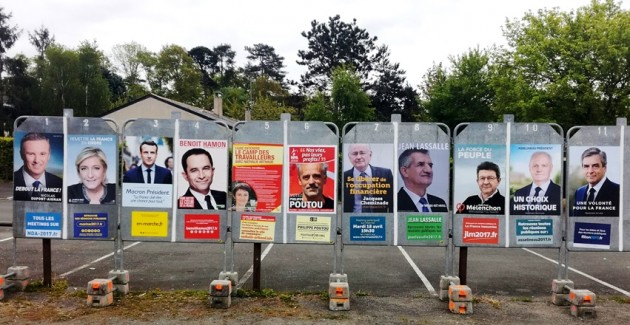 Slightly inclined election posters in Bouchemaine, Western France, April 2017